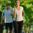 Young couple jogging — Stock Photo #12525575