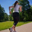Young beautiful  woman jogging - Foto Stock
