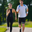 Young couple jogging — Stock Photo #12527679