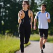 Young couple jogging — Stock Photo #12527843