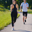 Young couple jogging — 图库照片