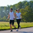 Young couple jogging — Stock Photo #12529057