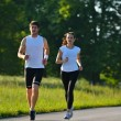 Young couple jogging — Stock Photo #12529068