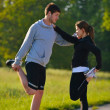 Couple doing stretching exercise after jogging — Stock Photo #12529287