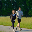 Young couple jogging — ストック写真