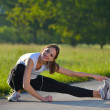 Woman stretching before fitness — Stock Photo #12530525