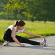Woman stretching before fitness — Stock Photo #12530556
