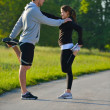 Couple doing stretching exercise  after jogging — Photo