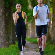 Young couple jogging — Photo