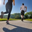 Young couple jogging — Stockfoto #12535050