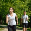 Young couple jogging at morning — Stock Photo