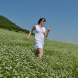 Young happy woman in green field — Stock Photo #12846545
