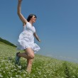 Young happy woman in green field — Stock Photo #12846565