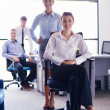 Business woman with her staff in background at office — Stock Photo #12871601
