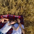 Happy couple in wheat field — Stock Photo #13121731