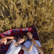 Happy couple in wheat field — Stock Photo #13121834