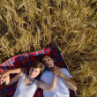 Happy couple in wheat field — Stock Photo #13121866