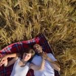 Happy couple in wheat field — Stock Photo