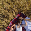 Happy couple in wheat field — Stock Photo #13122101