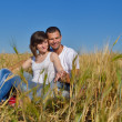 Stock Photo: Happy couple in wheat field