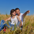 Happy couple in wheat field — Stock Photo