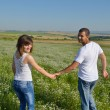 Happy couple in wheat field — Stock Photo #13123611
