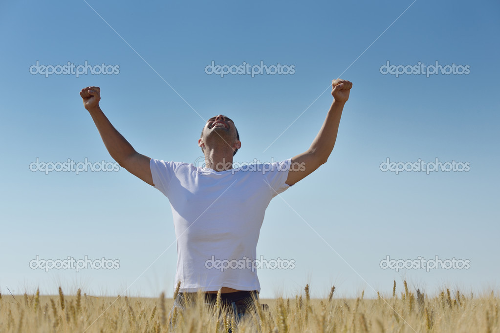 Young man in wheat field representing success agriculture and freedom concept — Stock Photo #13120762