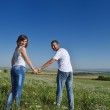 Happy couple in wheat field — Stock Photo #13149713
