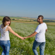 Happy couple in wheat field — Stock Photo #13149717