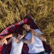 Happy couple in wheat field — Stock Photo #13150476