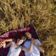 Happy couple in wheat field — Stock Photo #13150659