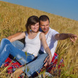 Happy couple in wheat field - ストック写真