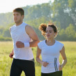 Young couple jogging at morning — Stock Photo #13213143