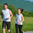 Young couple jogging at morning — Stock Photo #13213156