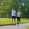Young couple jogging at morning - Stok fotoğraf