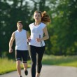 Young couple jogging at morning — Stock Photo #13213233