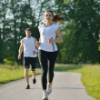 Young couple jogging at morning - Foto de Stock
