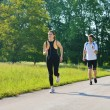 Young couple jogging at morning — Stock Photo #13213490