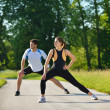 Couple doing stretching exercise  after jogging - Stockfoto