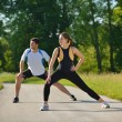 Couple doing stretching exercise after jogging — Stock Photo #13213607
