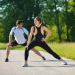 Couple doing stretching exercise after jogging — Stock Photo #13213614