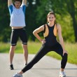 Couple doing stretching exercise after jogging — Stock Photo #13213625