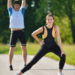 Couple doing stretching exercise after jogging — 图库照片