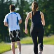 Young couple jogging at morning — Stockfoto