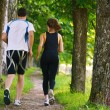 Young couple jogging at morning — Foto Stock