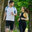 Young couple jogging at morning — Stok fotoğraf