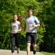 Young couple jogging at morning - Foto Stock