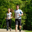 Young couple jogging at morning - Stock Photo