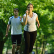 Young couple jogging at morning — Stock fotografie