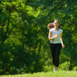 Young beautiful  woman jogging at morning in park — Stok fotoğraf